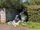 More flytipping in hedge on footpath